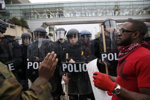 Police stand guard outside Camden Yards as protesters gather for a rally to protest the death of Freddie Gray who died following an arrest in Baltimore, Maryland April 25, 2015. (Photo by Shannon Stapleton/Reuters)