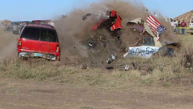 Daredevil John Smith, known as the Flying Farmer, crashes his Chevrolet Caprice while attempting a jump on Saturday, September 25, 2021 in Makoti, N.D. He suffered unknown injuries and was flown to a Minot hospital. (Photo by Hunter Andes/The Bismarck Tribune via AP Photo)