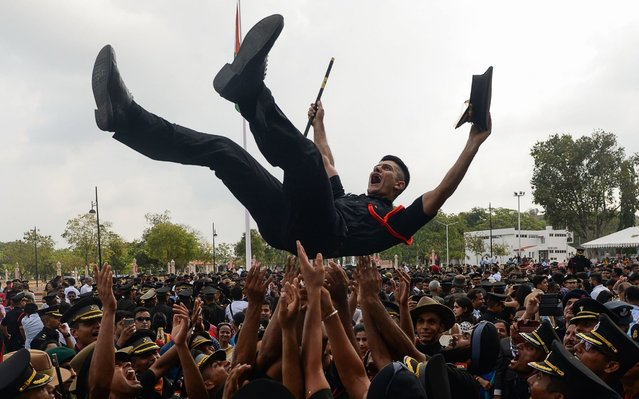 Indian army cadets celebrate after their graduation ceremony at the Officers Training Academy in Chennai on March 9, 2019. A total of 142 cadets including 30 women and 18 foreign cadets from Bhutan, Afghanistan and Fiji graduated from the academy and will be posted as lieutenants in the Indian Army. (Photo by Arun Sankar/AFP Photo)