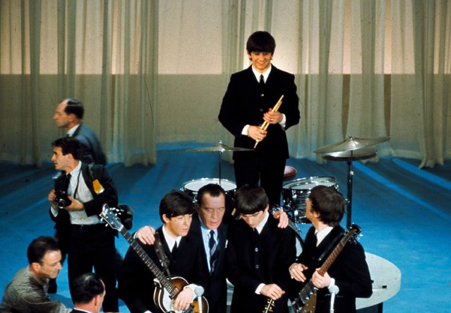 The British rock and roll group the Beatles are shown on stage with Ed Sullivan before their live television appearance on the The Ed Sullivan Show at CBS' Studio 50 in New York City, February 10, 1964. From left are, Paul McCartney, Sullivan, George Harrison, Ringo Starr, standing, and John Lennon. (Photo by AP Photo)