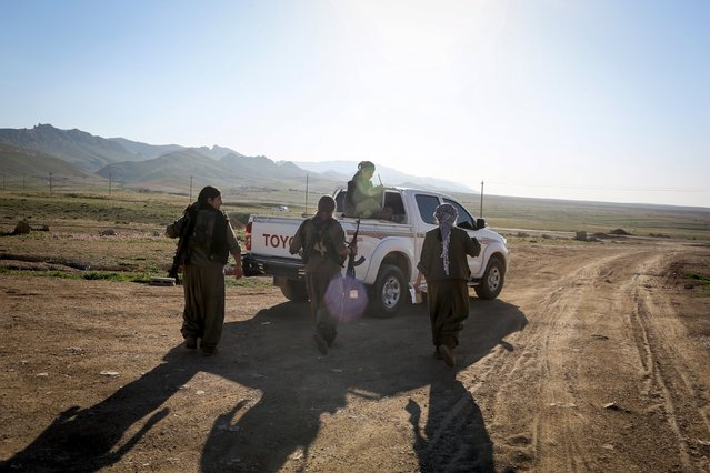 Kurdistan Workers Party (PKK) fighters leave their base in Sinjar, March 10, 2015. (Photo by Asmaa Waguih/Reuters)