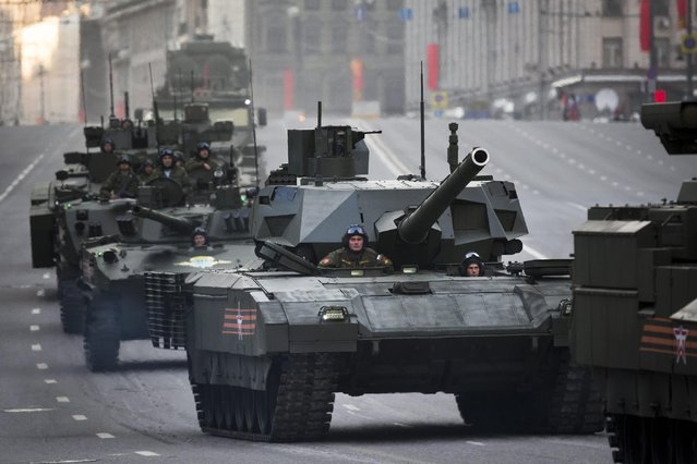 Russian military vehicles including the new Russian T-14 Armata tank, center, make their way to Red Square during a rehearsal for the Victory Day military parade which will take place at Moscow's Red Square on May 9 to celebrate 70 years after the victory in WWII, in Moscow, Russia, Monday, May 4, 2015. (Photo by Alexander Zemlianichenko/AP Photo)