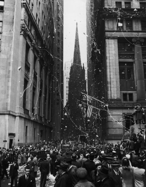 The corner of Wall Street and Nassau Street in New York City during the VE Day celebrations, 7th May 1945. Trinity Church looms in the background. (Photo by Archive Photos/Getty Images)