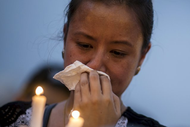 A woman from the Nepalese community cries during a candlelight vigil to mourn of the victims of the earthquake that devastated parts of Nepal a week ago, in Hong Kong, China May 2, 2015. (Photo by Tyrone Siu/Reuters)