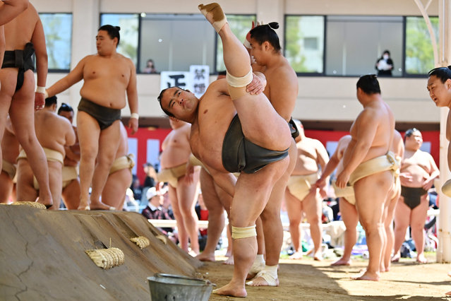 """Sumo wrestlers take part in a """"honozumo"""", a ceremonial sumo exhibition, on the grounds of Yasukuni Shrine in Tokyo on April 15, 2019. Sumo's top wrestlers took part in an annual one-day exhibition for thousands of spectators within the shrine's precincts. (Photo by Charly Triballeau/AFP Photo)"""
