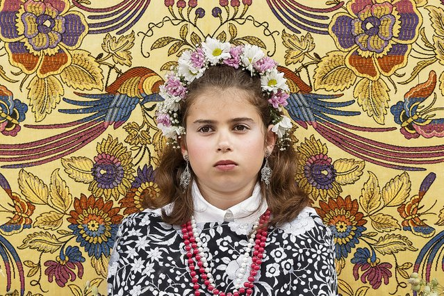 "A ""Maya"" girl sits in an altar during the traditional celebration of ""Las Mayas"" on the streets in Colmenar Viejo, near Madrid, Spain Saturday, May 2, 2015. (Photo by Daniel Ochoa de Olza/AP Photo)"