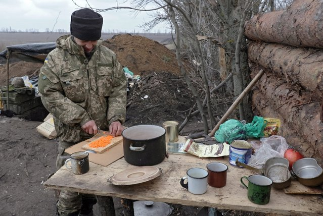 An Ukrainian serviceman cooks food in their position close to Kominternovo village, near Mariupol, Ukraine, 28 March 2016. Pro-Russian rebels attempted to storm one of the Ukrainian army strongholds near Avdiyivka. It is noted that the situation in the ATO zone remains tense, with pro-Russian rebels having attacked Ukrainian forces 18 times during the day, the Anti-Terrorist Operation (ATO) press center reported. (Photo by Sergey Vaganov/EPA)