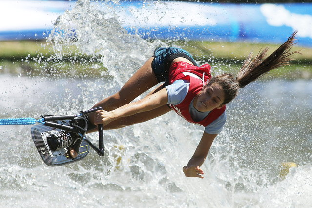 Peruvian Natalia Cuglievan performs during the Figure Waterskiing competition in the X Odesur Games at the Morros Lagoon in Santiago de Chile, Chile, March 8, 2014. (Photo by Mario Ruiz/EPA)