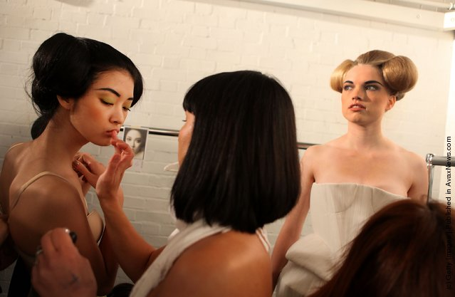 Models pose backstage at the Corrie Nielsen show at London Fashion Week Spring/Summer 2012