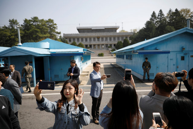 South Koreans take selfies as they tour the truce village of Panmunjom inside the demilitarized zone (DMZ) separating the two Koreas, South Korea, May 1, 2019. (Photo by Kim Hong-Ji/Reuters)