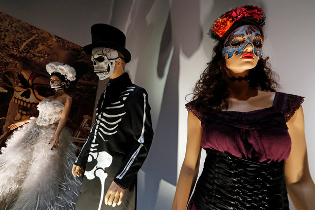 """Costumes used during the shooting of the movie """"Spectre"""" are displayed at the exhibition """"The Designing 007: Fifty Years of Bond Style"""" during a press presentation at the Grande Halle de la Villette in Paris, France, April 13, 2016. (Photo by Benoit Tessier/Reuters)"""