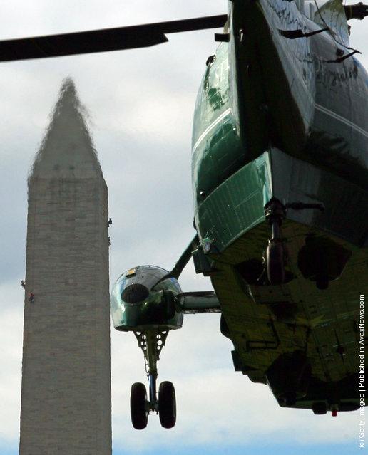 U.S. President Barack Obama walks toward Marine One while departing the White House