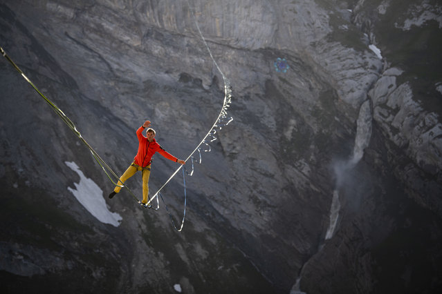 Lukas Irmler balances on a 800 meter long highline 200 meters above Segnesboden, on Friday, June 28, 2019, in Flims, Switzerland. The highline is Switzerland's longest and will be set up untill Sunday in the Sardona World Heritage Region. (Photo by Gian Ehrenzeller/Keystone via AP Photo)