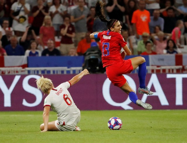 Alex Morgan of USA Women, Millie Bright of England Women during the World Cup Women match between England v USA at the Stade de Lyon on July 2, 2019 in Lyon France. (Photo by Bernadett Szabo/Reuters)