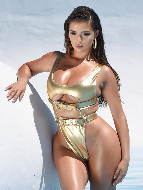 Model Demi Rose posed in a gold bikini in Los Angeles, California on July 9, 2019. The Birmingham-born beauty sent temperatures soaring as she showed off her curves in metallic swimwear during a photoshoot for her new bikini range with fashion brand Oh Polly. (Photo by KP Pictures)