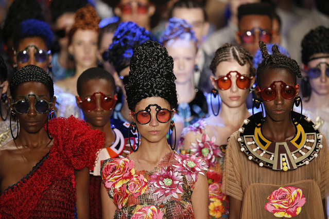 Models wear creations from the Ronaldo Fraga collection during the Sao Paulo Fashion Week in Sao Paulo, Brazil, Monday, April 25, 2016. (Photo by Andre Penner/AP Photo)