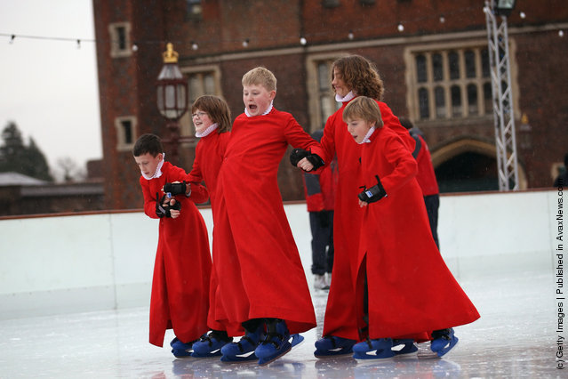 Members of Chapel Royal Choirboys choir attempt to skate during a photocall at the Hampton Court Ice Rink on December in London