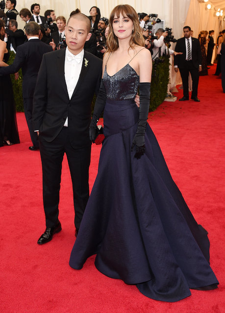 "Designer Jason Wu (L) and model Dakota Johnson attend the ""Charles James: Beyond Fashion"" Costume Institute Gala at the Metropolitan Museum of Art on May 5, 2014 in New York City. (Photo by Larry Busacca/Getty Images)"