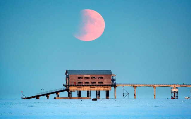 The lunar eclipse over Bembridge lifeboat station on the Isle of Wight, England on July 16, 2019. (Photo by Bournemouth News and Picture Service)