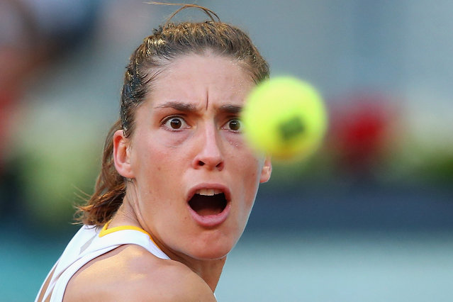 Andrea Petkovic of Germany in action against Sara Errani of Italy during day one of the Mutua Madrid Open tennis tournament at the Caja Magica on May 3, 2014 in Madrid, Spain. (Photo by Julian Finney/Getty Images)