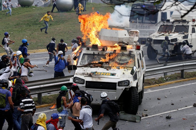 Demonstrators clash with a riot police armored car during a rally against Venezuela's President Nicolas Maduro in Caracas, Venezuela on May 2, 2017. (Photo by Carlos Garcia Rawlins/Reuters)