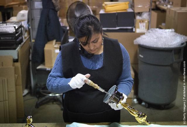 Josefina Govea assembles an Oscar statuette at R.S. Owens & Company