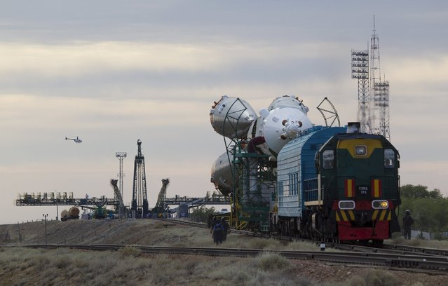 The Soyuz TMA-17M spacecraft is transported from an assembling hangar to its launch pad at the Baikonur cosmodrome, Kazakhstan, July 20, 2015. (Photo by Shamil Zhumatov/Reuters)