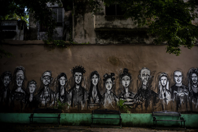 In this November 10, 2019 photo, a wall is covered by a mural of faces, representing local residents, in a plaza in Old Havana, Cuba. The city will celebrate its 500th anniversary on Nov. 16. (Photo by Ramon Espinosa/AP Photo)