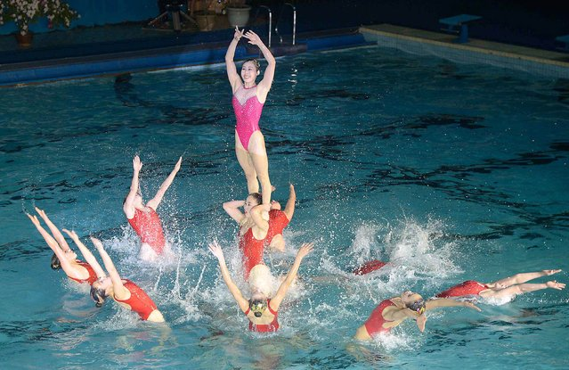 Synchronized swimmers perform during an event to celebrate the birth anniversary of North Korea's late leader Kim Jong Il in Pyongyang February 15, 2015, in this picture provided by Kyodo. Sporting events took place in Pyongyang to celebrate a day before the anniversary of the birth of North Korea's late leader Kim Jong Il. (Photo by Reuters/Kyodo News)