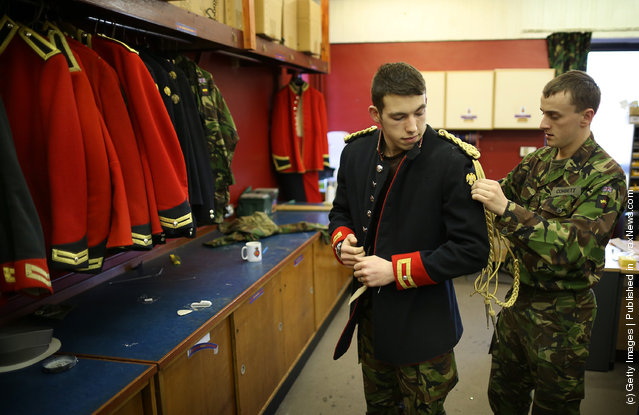 Trooper Matthew Vass (R) fits Trooper Bradley Corbett of The Household Cavalry Mounted Regiment (HCMR) with a Blues and Royals tunic in the Tailor Shop at Hyde Park Barracks