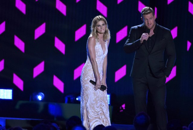 Show hosts Erin Andrews and J.J. Watts speak on stage at the 2016 CMT Music Awards in Nashville, Tennessee, U.S. June 8, 2016. (Photo by Harrison McClary/Reuters)