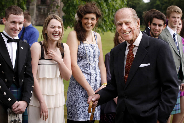Prince Phillip, The Duke of Edinburgh attends the Presentation Receptions for The Duke of Edinburgh Gold Award holders,on July 16, 2010 at the Palace of Holyroodhouse in Edinburgh.  Since 1958 The Duke of Edinburgh Awards has challenged over six million young people around the world to try new things, learn more about themselves and work together for their own benefit and that of their local communities. (Photo by Danny Lawson – WPA Pool/Getty Images)