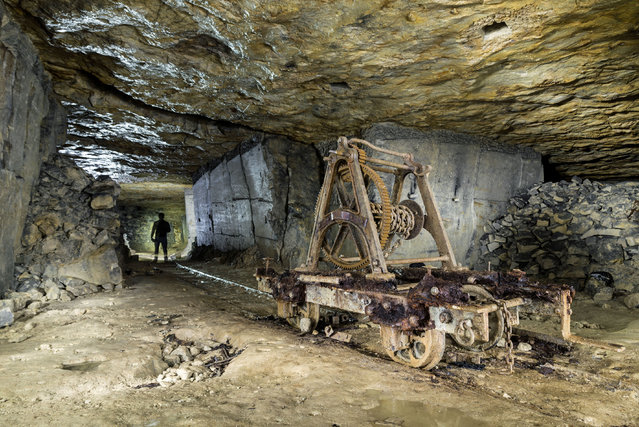 The abandoned Box Freestone Mine looks derelict and dangerous in this photo. The tunnels are normally pitch black which make it extremely difficult for Mike to get these shots. (Photo by Mike Deere/Caters News)