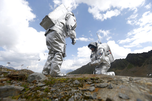 Inigo Munoz Elorza of Spain and Stefan Dobrovolny of Austria (R) take stone samples during a simulated Mars mission on Tyrolean glaciers in Kaunertal August 7, 2015. (Photo by Dominic Ebenbichler/Reuters)