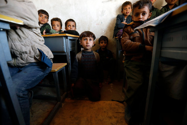 Yemeni children attend class at a school on the outskirts of Sana'a, Yemen, 18 November 2019. The war in Yemen, which has dragged on for nearly five years, has affected over 12 million children, the United Nations says. (Photo by Yahya Arhab/EPA/EFE)