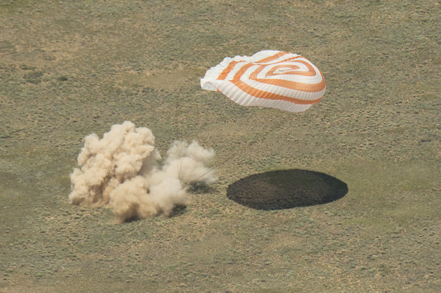 The Soyuz TMA-19M spacecraft is seen as it lands with Expedition 47 crew members Tim Kopra of NASA, Tim Peake of the European Space Agency, and Yuri Malenchenko of Roscosmos on June 18, 2016 near the town of Zhezkazgan, Kazakhstan. Kopra, Peake, and Malenchenko are returning after six months in space where they served as members of the Expedition 46 and 47 crews onboard the International Space Station. (Photo by Bill Ingalls/NASA via Getty Images)
