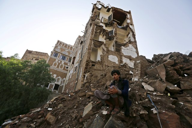 A man sits at a site which the Houthi-led authorities say was hit by a Saudi-led air strike at the old quarter of Yemen's capital Sanaa August 9, 2015. (Photo by Khaled Abdullah/Reuters)