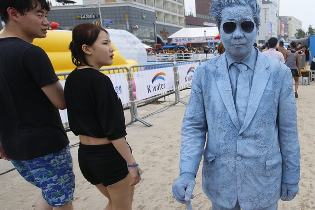 A festival-goer attends at the 20th Boryeong Mud Festival on Daecheon beach in Boryeong City, some 190 kilometers west of Seoul, South Korea, 22 July 2017. (Photo by Jeon Heon-Kyun/EPA/EFE)