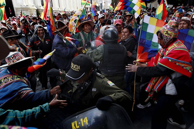 In La Paz, Bolivia, members of indigenous communities from the Mallku Kota region clash with police officers during a protest against mining operations on their lands by the Canadian mining company South American Silver Corp on June 7, 2012