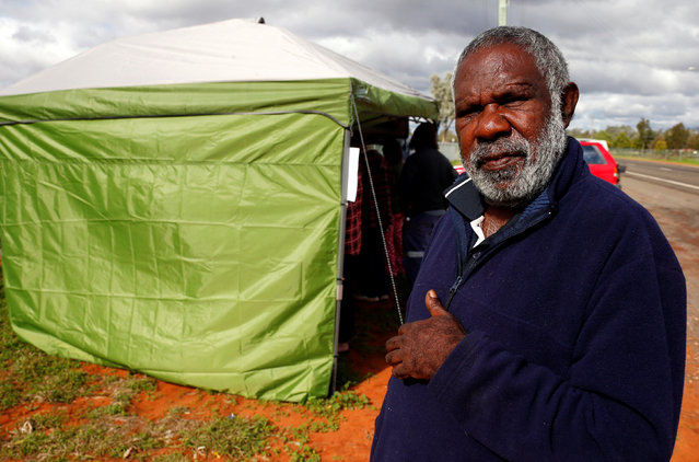 Gordon Sullivan, from a local Aboriginal community, poses near a remote voting station after he voted in the western New South Wales outback town of Enngonia,  Australia, June 22, 2016. (Photo by David Gray/Reuters)
