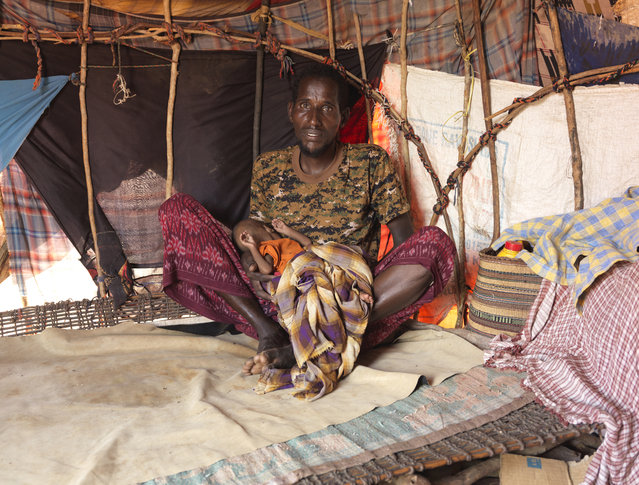 Reports say that the Islamist group al-Shabaab has banned aid from reaching the regions it controls. Violence is compounding the humanitarian situation. Al-Shabaab control much of the countryside and have told Somalis they will be punished for contacting humanitarian organisations. Isaak Hassan's seven-month-old daughter, Nadifo, is malnourished. They now live at Dusta camp. (Photo by Peter Caton/Mercy Corps)