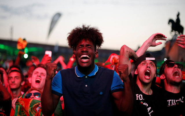 Fans of Portugal react as they watch the Euro 2016 match between Portugal and Wales at a public screening in downtown Lisbon, Portugal, July 6, 2016. (Photo by Rafael Marchante/Reuters)