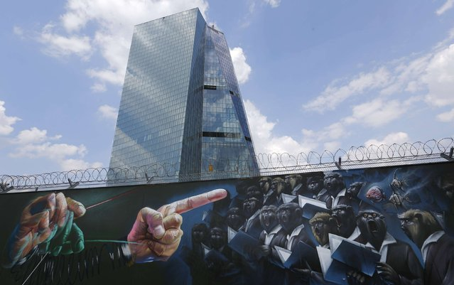 Graffiti is sprayed on a fence surrounding the construction site for the new headquarters of the European Central Bank (ECB) in Frankfurt, August 6, 2014. The ECB council will hold its monthly meeting on Thursday. (Photo by Kai Pfaffenbach/Reuters)