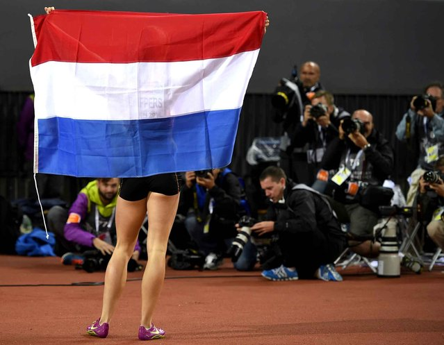 Netherlands' Gold medalist Dafne Schippers poses for photographers after winning the Women's 100m final during the European Athletics Championships at the Letzigrund stadium in Zurich on August 13, 2014. (Photo by Fabrice Coffrini/AFP Photo)