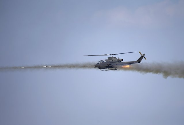 A South Korean army AH-1S helicopter participates in a U.S.-South Korea joint live-fire military exercise at a training field near the demilitarized zone separating the two Koreas in Pocheon, South Korea, August 28, 2015. (Photo by Kim Hong-Ji/Reuters)