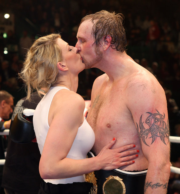 Robert Helenius (R) of Finland and his wife Sandra celebrate after winning the WBO WBA Intercontinental Heavyweight title fight against Samuel Peter of Nigeria at Gerry Weber Stadion on April 2, 2011 in Halle, Germany.  (Photo by Boris Streubel)