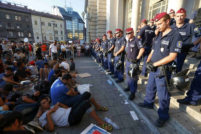 Migrants form a sit-down demonstration as police block the entrance to the main Eastern Railway station in Budapest, Hungary, September 1, 2015. (Photo by Laszlo Balogh/Reuters)