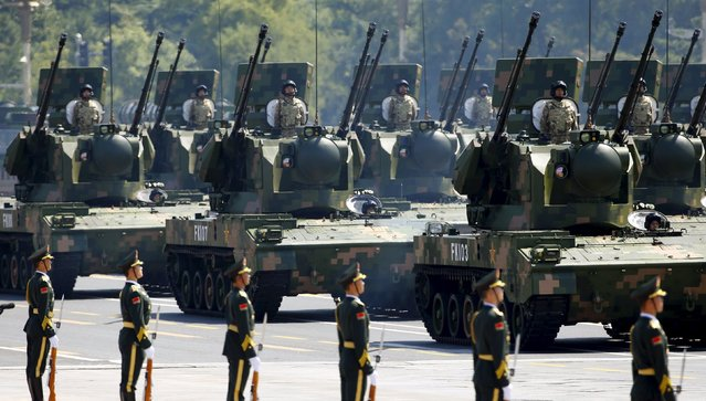 Anti-aircraft artillery are displayed during the military parade to mark the 70th anniversary of the end of World War Two, in Beijing, China, September 3, 2015. (Photo by Damir Sagolj/Reuters)