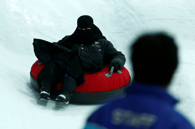 A veiled woman enjoys a ride in the new Snow City at Al Othaim Mall in Riyadh, July 26, 2016. (Photo by Faisal Al Nasser/Reuters)