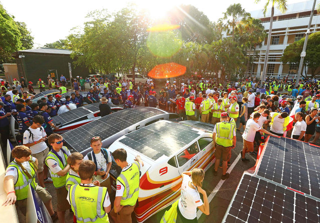 This handout from the World Solar Challenge 2017 taken and received on October 8, 2017 shows a general view as solar race cars prepare to leave the start line in Darwin as racing begins The World Solar Challenge, an epic 3,000- kilometre (1,860- mile) solar car race across outback Australia, has become one of the world's foremost innovation challenges with teams looking to demonstrate designs that could one day lead to solar- powered cars for consumers that can carry passengers. (Photo by Scott Barbour/AFP Photo/World Solar Challenge 2017)